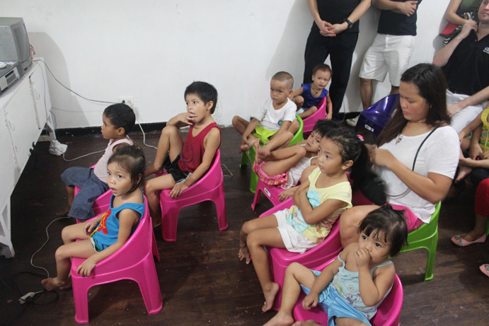 The children using the new chairs they received from TrueLogic